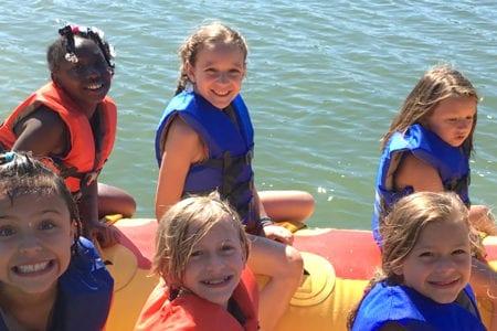 Kids Riding Water Tube - Camp Ernst